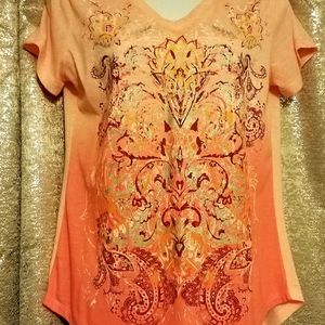 womens small top but it fits more like a